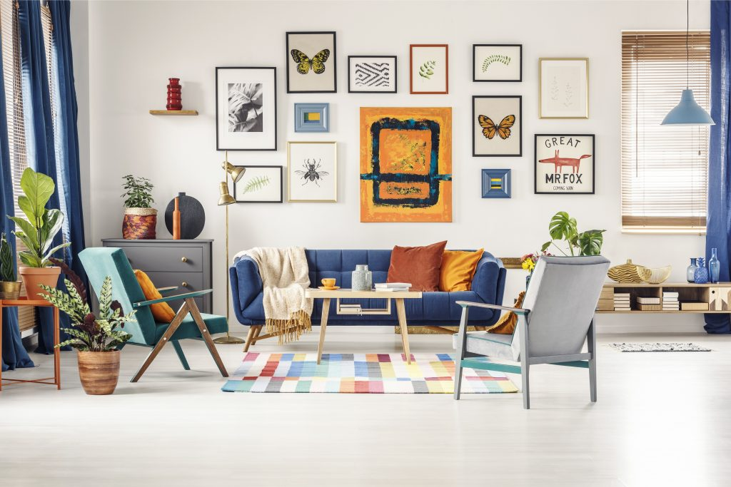 A living room with a gallery wall